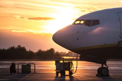 Parked,Airplane,Side,View,Backlit,,Sunset,Time.,Narrow,Body,Commercial