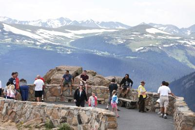 FILE - Tourists in Rocky Mountain National park
