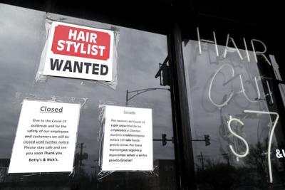 FILE - barber shop, hair salon, Illinois, Virus Outbreak Illinois Unemployment
