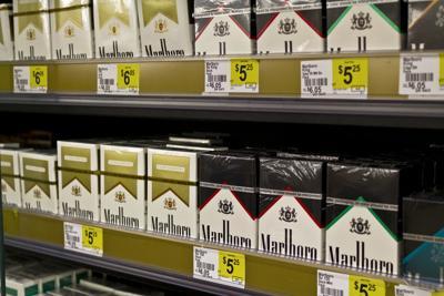 FILE - cigarette, smoking ban, smoker