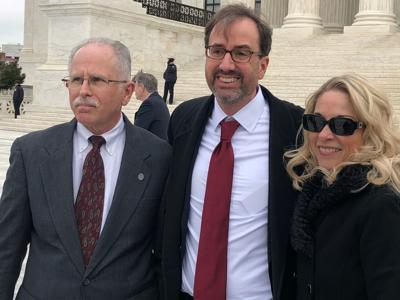 FILE - Mark Janus at SCOTUS with Robert Alt