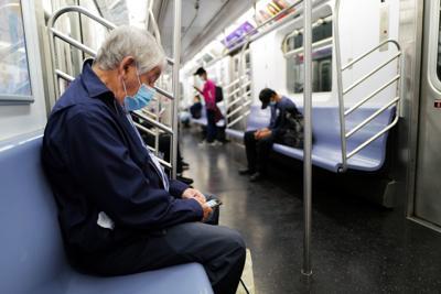 FILE - NY senior citizen, subway 6-9-2020