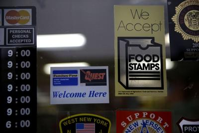 FILE - SNAP Food Stamps