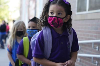 FILE - Virus Outbreak Colorado Schools