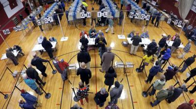 FILE - ME voting, voters, election