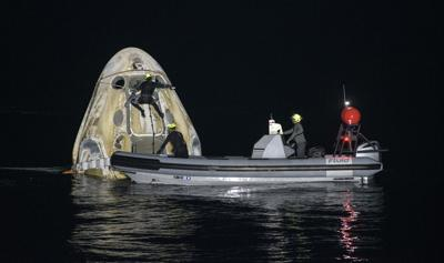 FILE - SpaceX Astronauts Return