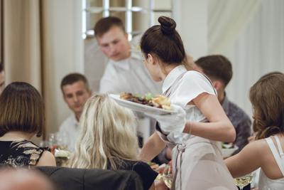 FILE - Restaurant worker waiter waitress