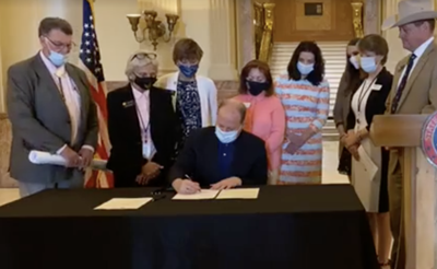 Polis Signs Colorado Prescription Drug Bill