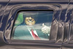 Trump issues pardon, waves to Florida supporters in last presidential motorcade