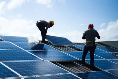FILE - Solar panels