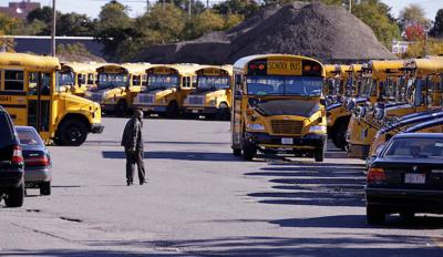 FILE - MA school buses 10-8-2013