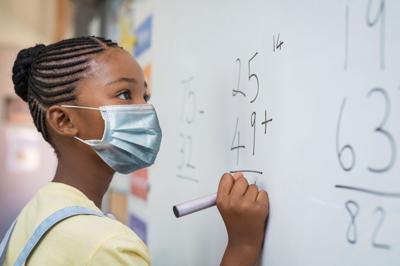 FILE - Student wearing mask