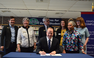 FILE - Gov. Polis signs education bills