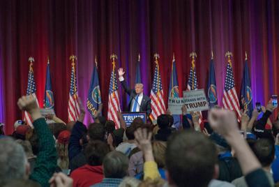 FILE - Political caucus
