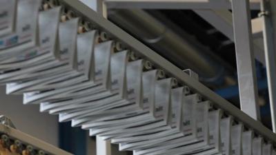 Newspaper press inserter