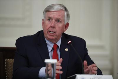 FILE - Mike Parson, Virus Outbreak Trump