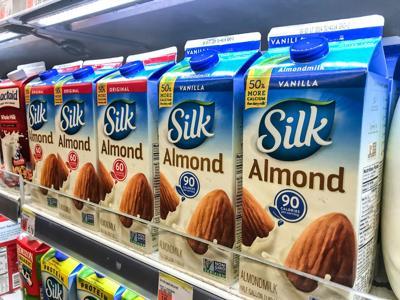 FILE - Soy milk Almond milk