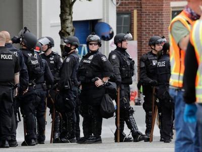 FILE - Seattle Cops