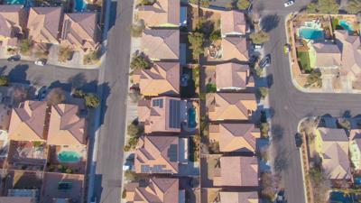 FILE - Suburban neighborhood