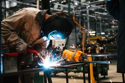 FILE - Factory worker, welder