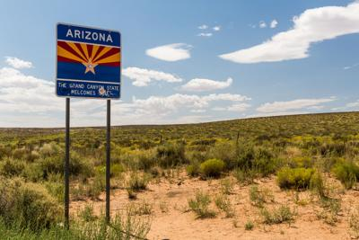 FILE - Welcome to Arizona sign
