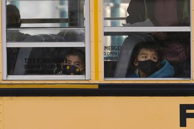 FILE - students. on bus, in-person class, mask, Virus Outbreak Illinois