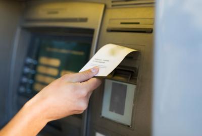 FILE - Check deposit, tax refund