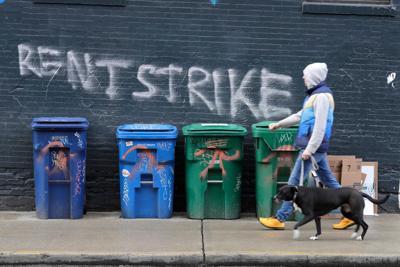 FILE –Rent strike graffiti