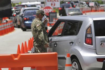 FILE - Florida National Guard, Virus Outbreak Florida