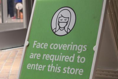 FILE —Oregon face masks sign