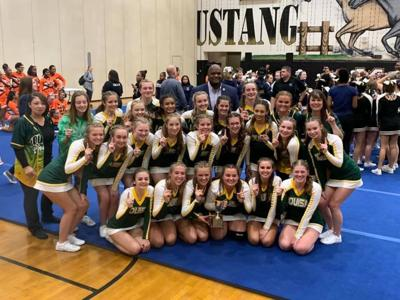 Cheer team defends district title