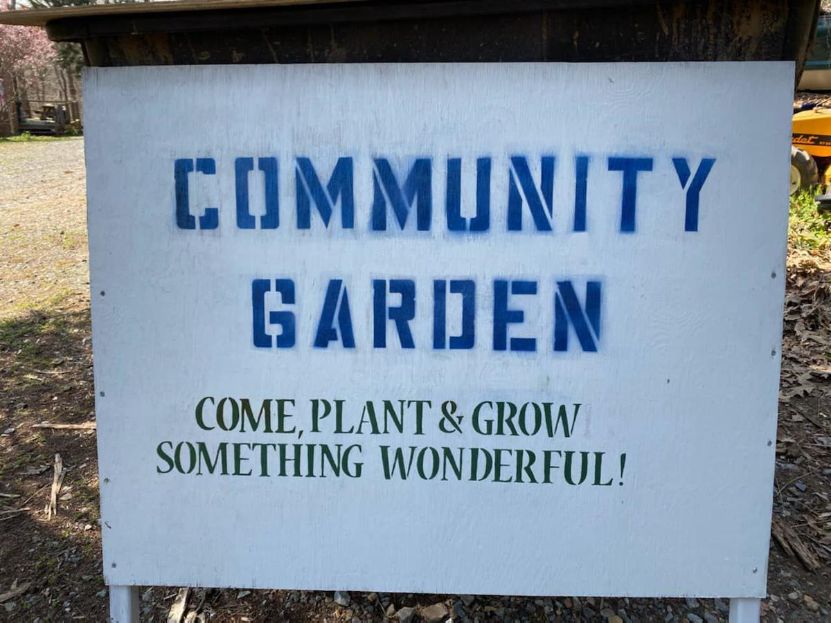 Holly Grove community garden welcome sign