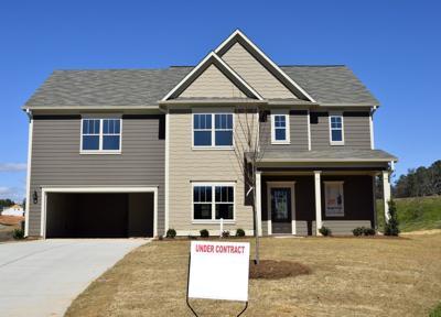 large brick home (stock image)