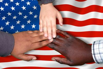Racism - Hands with American Flag Background
