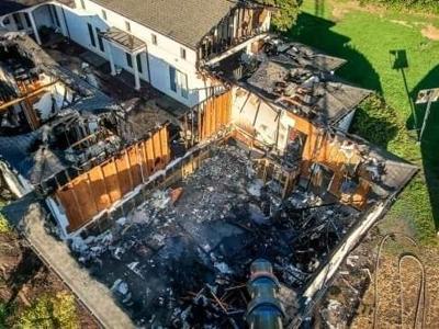Fire levels house near lake
