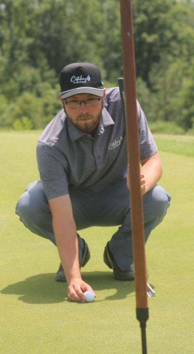 Golfer is a pro at lake course