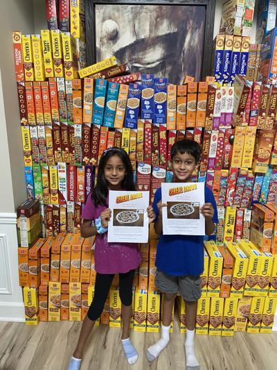 Amisha and Ronak Ghelani hold cereal drive