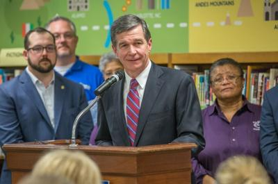 Cooper keeps state restrictions in place for five more weeks
