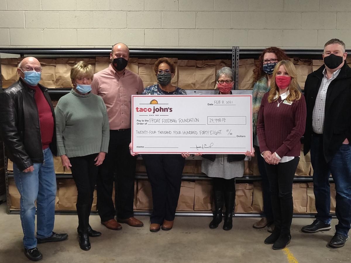Taco John's Donation to Friday Food Bag Foundation photo