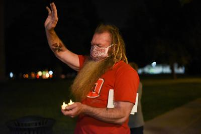 """Roy """"Sparky"""" Richarson holds candles during the vigil for Justice Ruth Bader Gingsburg"""