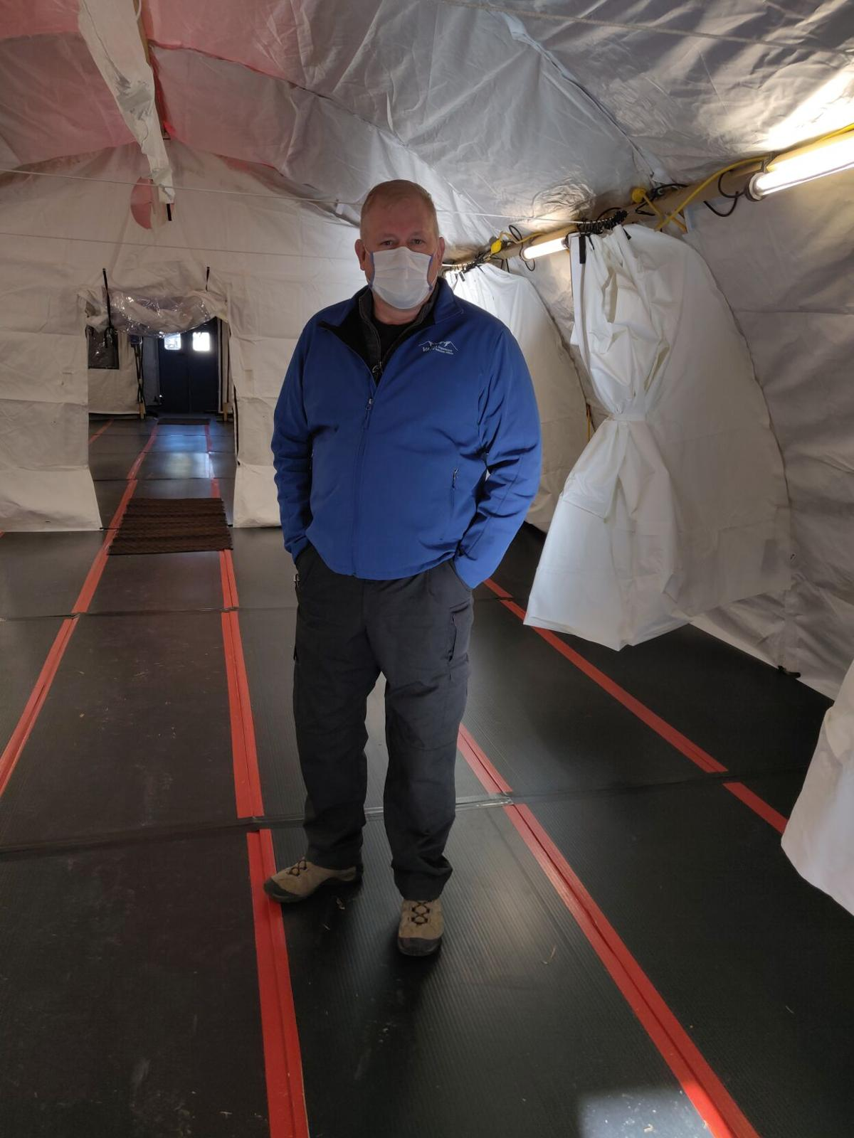 Erich Kurtz stands inside one of the tents erected to handle Covid patients
