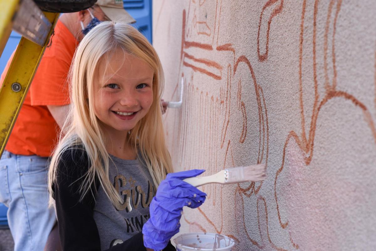 Peyton Meyer paints community mural
