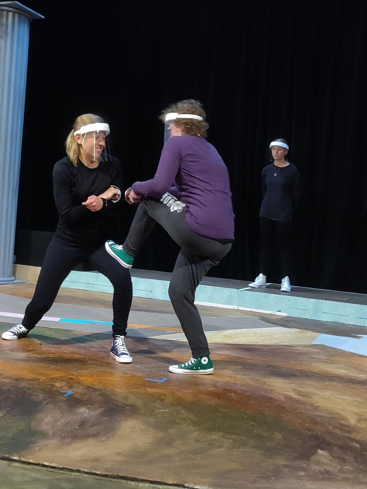 Sequoia Nelson (L) and Nancy Stange (R) practice a sword fighting scene