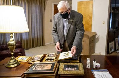 Mike Enzi sorts through photographs