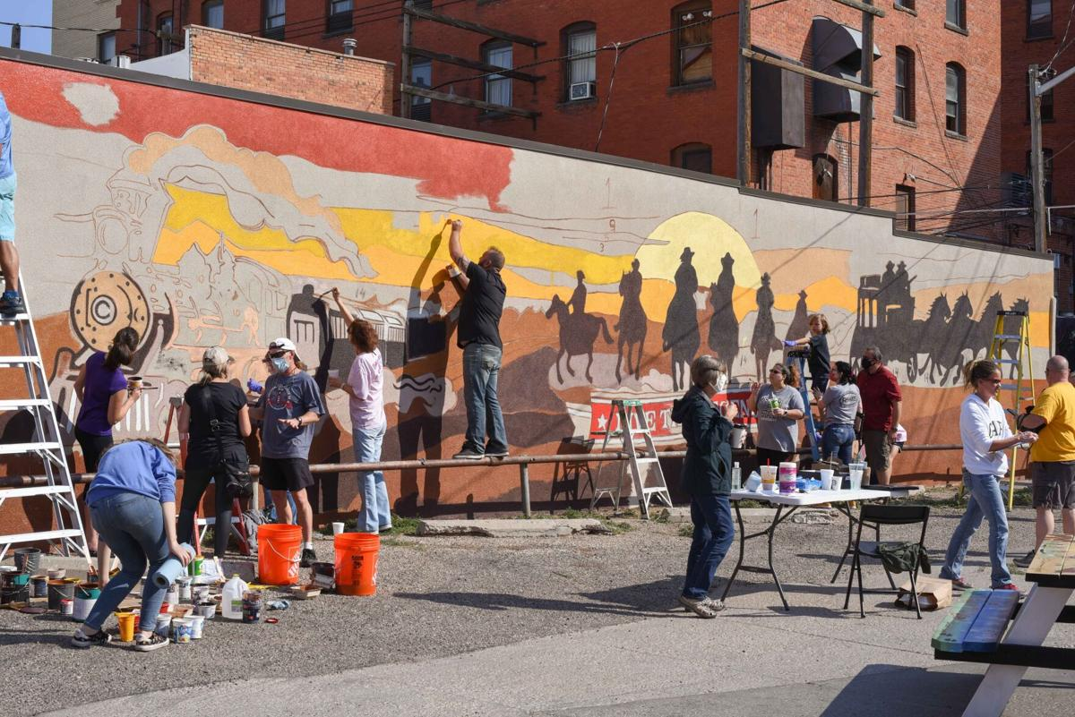 """Community members bring to life the """"Live the Legend '' mural"""