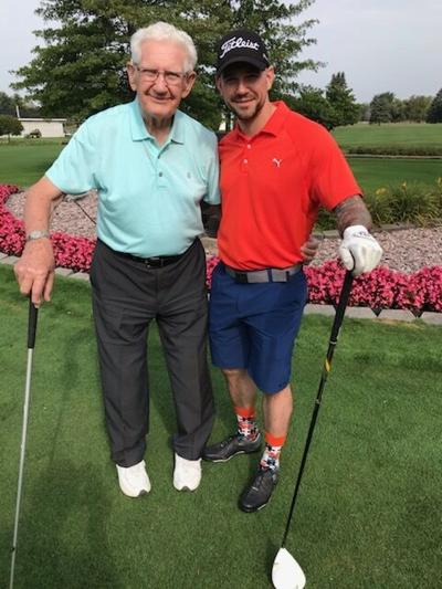 Jay Grzegorczyk and his grandson J play golf.