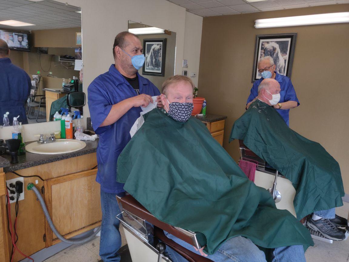 Barbers and customers wear face masks at Trujillo's Barber Shop