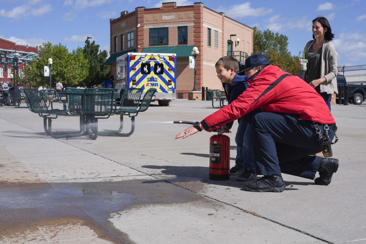 Cheyenne Firefighter demonstrates use of a fire extinguisher