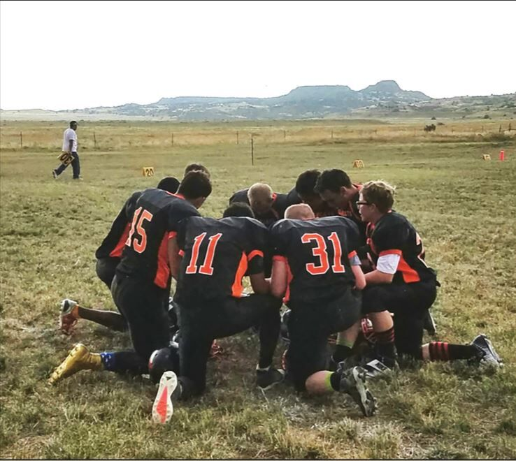 The Branson Bearcats 6-man high school football team says a prayer on their home field, where other schools have announced that they'll no longer play because of safety concerns.