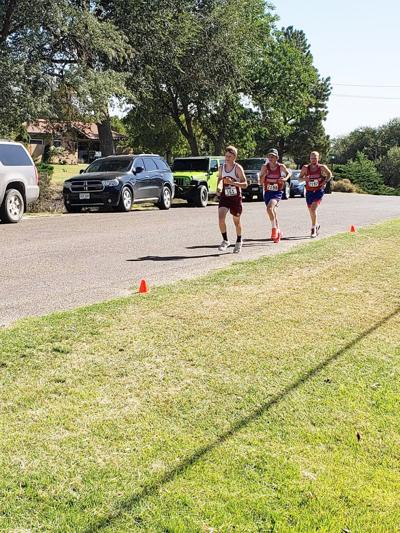 Brock Doherty, left, leads Springfield's Mylo Lovejoy, center, and Hayden Lasley at the southeastern Colorado invitational.
